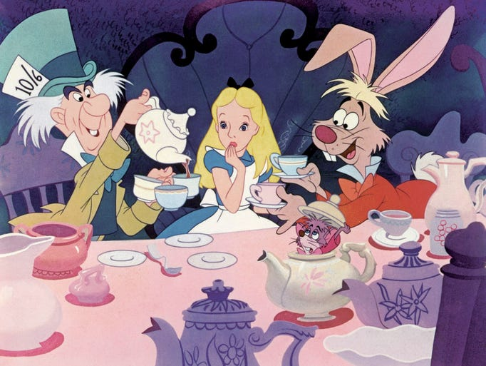"The Mad Hatter, Alice, March Hare and Dormouse in the 1951 film ""Alice in Wonderland."""