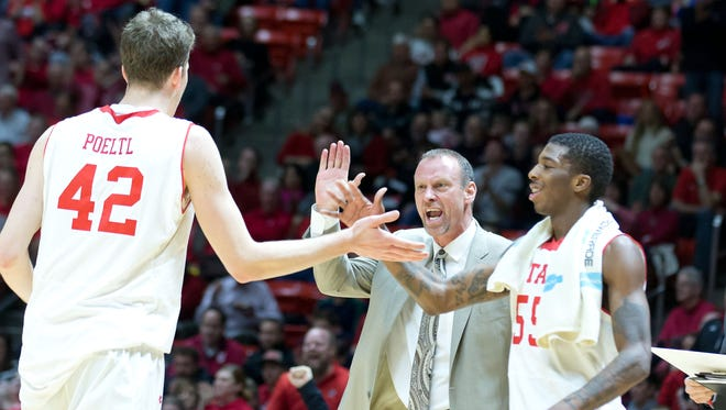 Utah Utes forward Jakob Poeltl (42) and guard Delon Wright (55) and head coach Larry Krystkowiak react during the first half against the Colorado Buffaloes at Jon M. Huntsman Center.