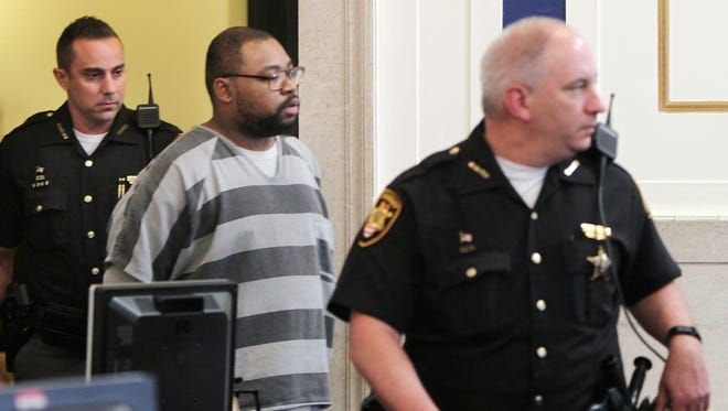 Glen Bates, charged with aggravated murder in the death of his 2-year-old daughter Glenara, enters Hamilton County Court for arraignment.  Judge Megan Shanahan ordered him held without bond.  He faces the death penalty if convicted.