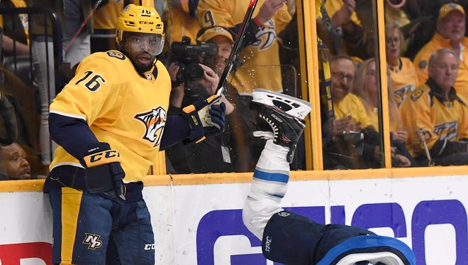 Jets center Mark Scheifele (55) hits the ice in front of Predators defenseman P.K. Subban (76) during the second period in Game 2 of the second round NHL Stanley Cup Playoffs at the Bridgestone Arena Sunday, April 29, 2018, in Nashville, Tenn.