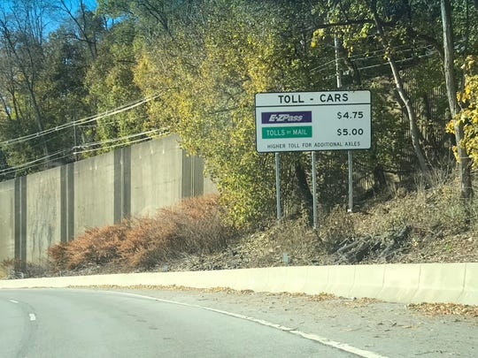 A sign on the South Nyack entrance of the eastbound Thruway lists toll fees for the Governor Mario M. Cuomo Bridge.
