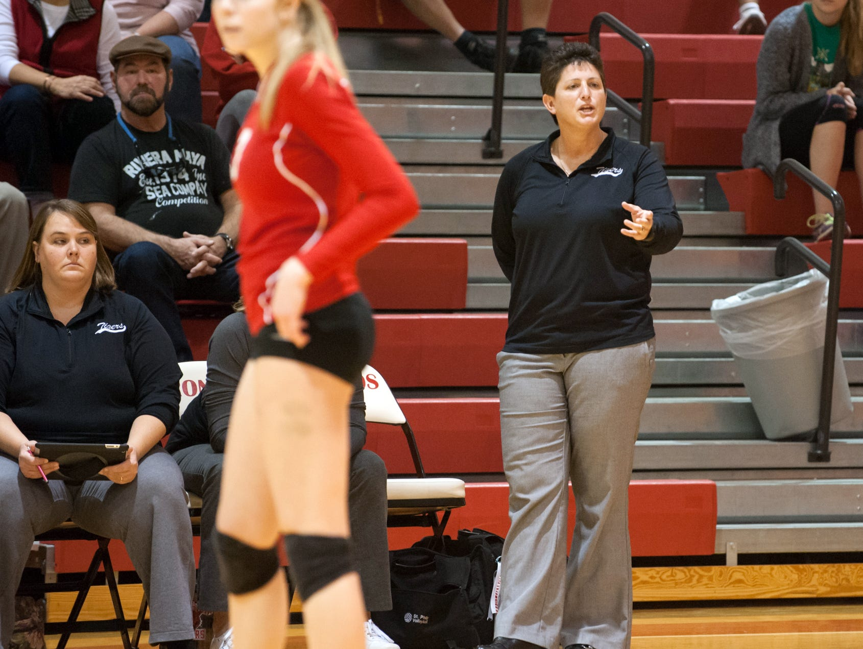St. Philip head coach Vicky Groat talks to players during a break in action Tuesday night as they faced off against Marshall Academy.