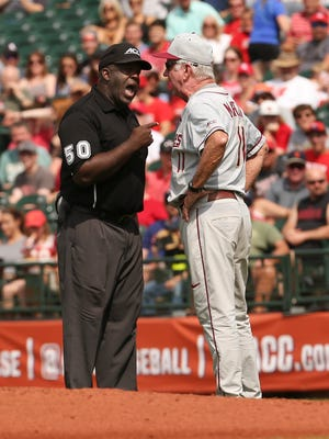 FSU head coach Mike Martin, right, had words with umpire Troy Fullwood as they played U of L at Slugger Field during the ACC Tournament. May 26, 2017