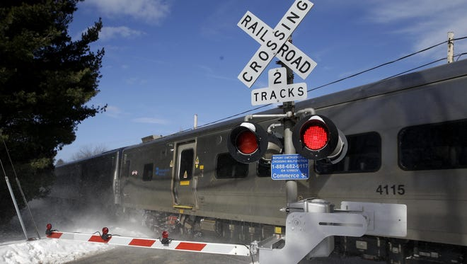 A train passes through the intersection where an SUV was struck by a train in Valhalla on Feb. 5.