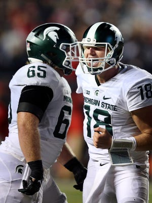 Michigan State quarterback Connor Cook (18) celebrates with offensive lineman Brian Allen (65) against Rutgers on Oct. 10, 2015.