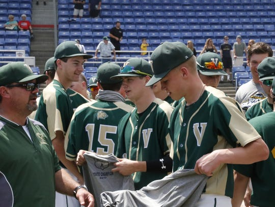 Players and coaches on the Vestal baseball team celebrate