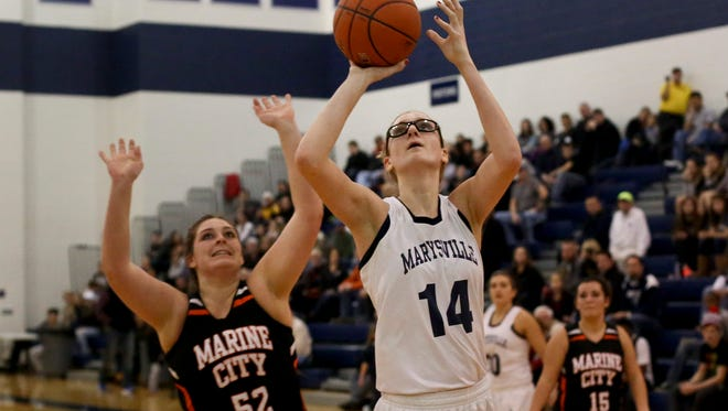 Marysville senior Payton Husson takes a shot during a basketball game Friday, Jan. 8, 2016 at Marysville High School.