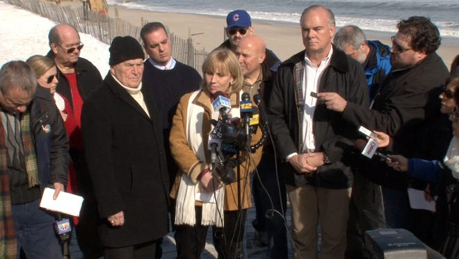 Lt Governor Kim Guadagno is joined by Toms River Mayor Thomas Kelaher (left) and DEP commissioner Bob Martin (right) during a survey of damage done to the coastline from the weekend Nor'easter in Ortley Beach, NJ, of Monday, January 25, 2016.