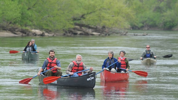 Hartwell Carson, the French Broad Riverkeeper, left, paddles alongside Steve with a group down the French Broad River.