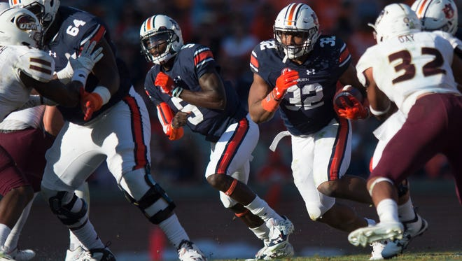 Auburn Tigers running back Malik Miller (32) runs downfield during the Auburn vs. ULM NCAA football game on Saturday, Oct. 1, 2016, in Auburn, Ala.