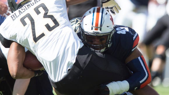 Auburn linebacker Darrell Williams (49) tackles Vanderbilt