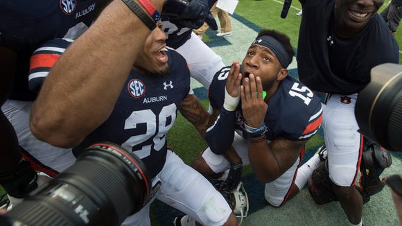 Auburn defensive back Joshua Holsey (15) and Auburn defensive back Tray Matthews (28) make faces in front of camera's after the NCAA football game between Auburn and Vanderbilt Saturday, Nov. 5, 2016, at Jordan-Hare Stadium in Auburn, Ala. Auburn defeated Vanderbilt 23-16.