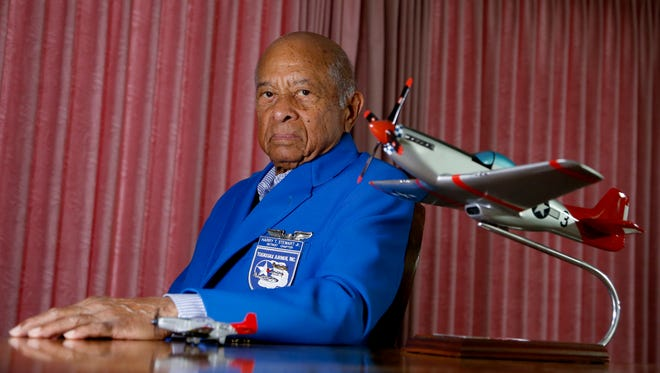 Tuskegee Airman Harry Stewart with a model of the P51 Mustang that he flew in World War II, in his Bloomfield Township home on Thursday, May 3, 2018.