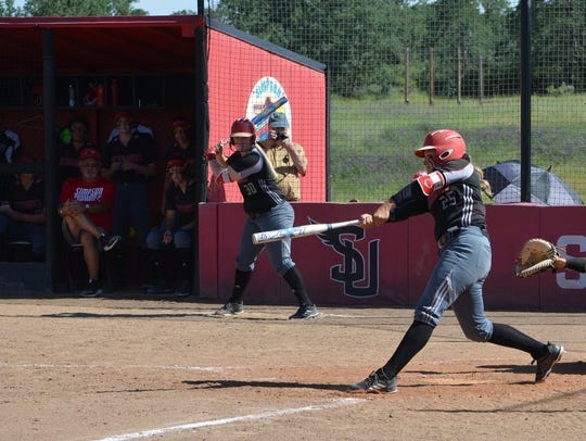 Mia Olvera belts the ball for Simpson University. The