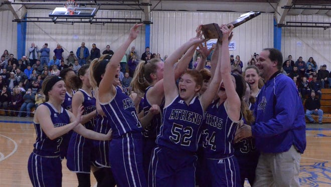 The Athens girls basketball team celebrates their Class D regional championship at Burr Oak on March 8, 2018.
