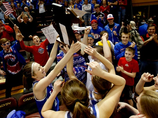 Adrian Lenawee Christian celebrates with the trophy