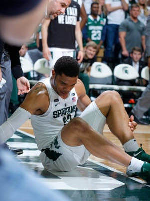 Michigan State's Miles Bridges reacts after going down with an injury during the second half of an NCAA college basketball game against Stony Brook, Sunday, Nov. 19, 2017, in East Lansing, Mich.