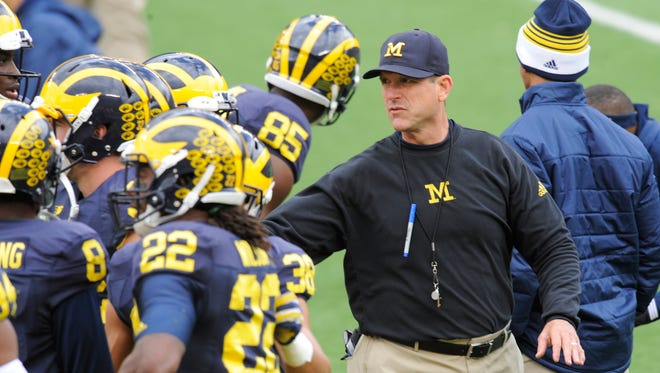 Jim Harbaugh prefers pleated khakis; his wife does not.