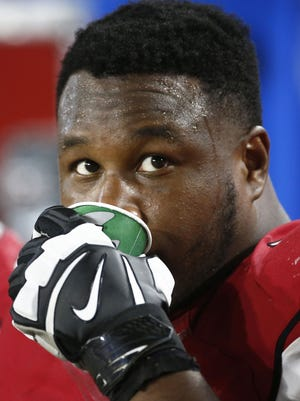 Arizona Cardinals' D.J. Humphries sits on the bench against the Kansas City Chiefs during preseason action at the University of Phoenix Stadium in Glendale, Az., Saturday, August 15, 2015.