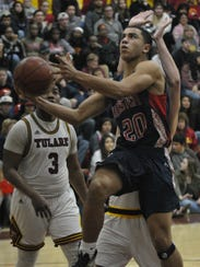 Tulare Western's Ira Porchia gets a layup against Tulare