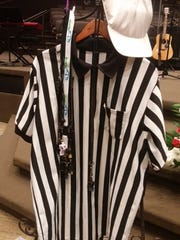 Other area referees hung their whistles on Rick Stillion's jersey during his funeral service.