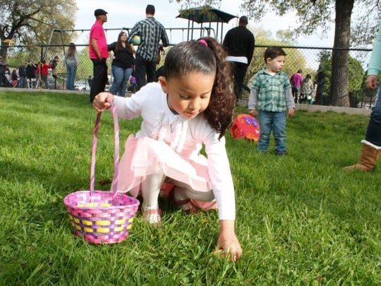 Juliet Sigala, 5, finds a colored egg during last year's Lions Club Community Egg Hunt  in Shasta Lake, where about 300 people participated.