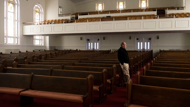 Rev. Don Olive inside the worship hall at Fifth Avenue Baptist Church. The hall seats up to 500 people comfortably but once had as many as a thousand people in attendance.