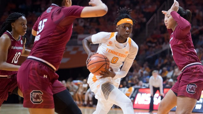 Tennessee's Rennia Davis tries to get past South Carolina's Alexis Jennings, left, and South Carolina's LaDazhia Williams on Sunday, February 25, 2018.