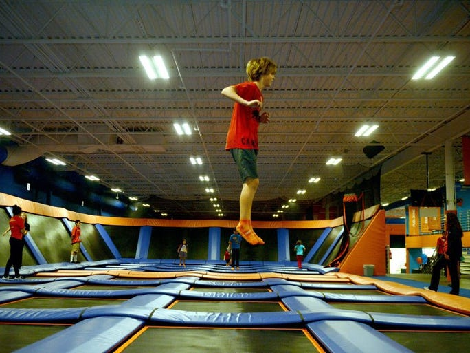 KAREN QUINCY LOBERG/THE STAR Kaid Himle traverses the room bouncing from trampoline to trampoline Sunday at the newly opened Sky Zone Trampoline Park in Ventura.