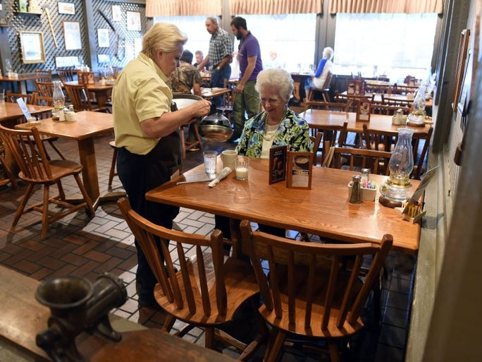 Helen Hill serves customer Emma Brummett at the Rocky Top Cracker Barrel location Friday Sept. 9, 2016. Hill is retiring after 40 years of working for the company.