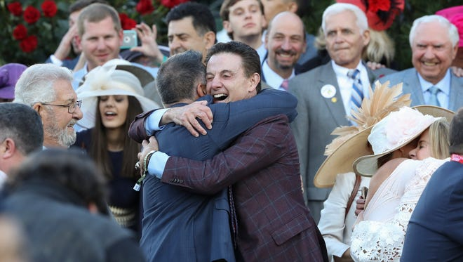 Rick Pitino celebrates after Always Dreaming's win in the Kentucky Derby at Churchill Downs on May 6, 2017.
