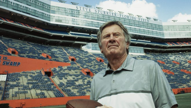 Steve Spurrier stands on the football field at University of Florida, named after him for his achievements as a player and a coach.