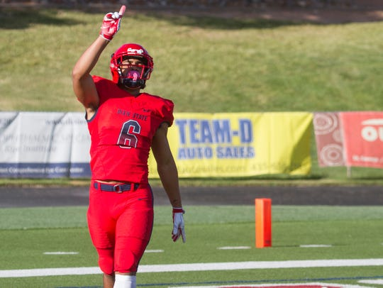 Dixie State's Orlando Wallace celebrates after scoring