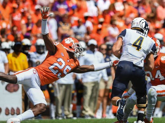 Clemson defensive back Marcus Edmond (29) tries to stop Kent State quarterback Nick Holley (4) during the 2nd quarter on Saturday, September 2, 2017 at Clemson's Memorial Stadium.