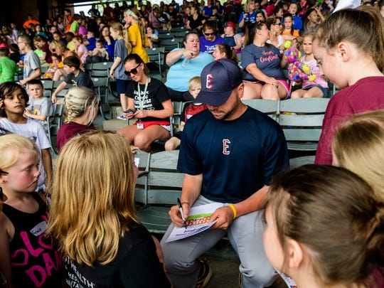 Evansville Otters player Greg Stagani (center) signs autographs for Daniel Wertz Elementary School students during an Education Day Exhibition game against the Florence Freedoms at Bosse Field in Evansville, Ind., Wednesday, May 2, 2018.
