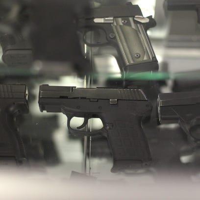 Hand guns are displayed at Talon shooting range Saturday
