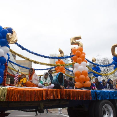 Members of Arizona's Sikh community march in a parade