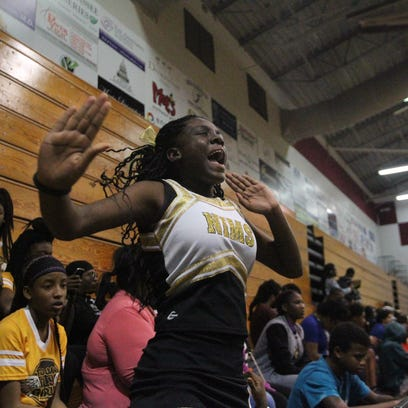 Eighth-grader Tianiya Hall-Scales is the only cheerleader