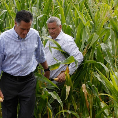 Mitt Romney walks with Iowa Agriculture Secretary Bill