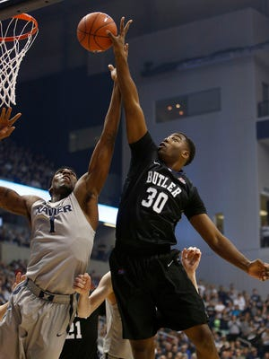 Butler forward Kelan Martin (30) goes up for a shot against Xavier forward Jalen Reynolds (1) in the first half of an NCAA college basketball game, Saturday, Feb. 21, 2015, in Cincinnati.
