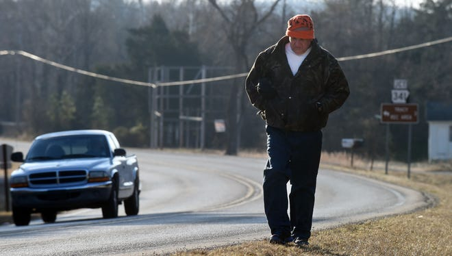 Sam Gardner, 54, of Briarcliff, walks Thursday along AR Highway 5 on the way to his job in Mountain Home. Gardner makes the 16-mile, round-trip commute, by foot, five days a week.