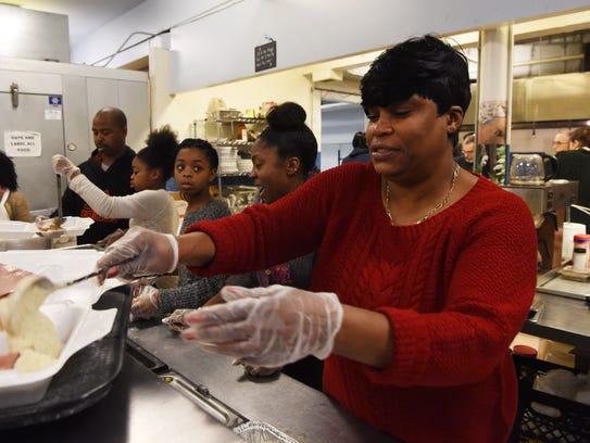 Volunteer Ionie Ellis of the Town of Poughkeepsie loads