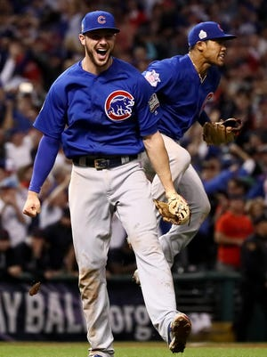 CLEVELAND, OH - NOVEMBER 02: Kris Bryant #17 and Addison Russell #27 of the Chicago Cubs celebrate after defeating the Cleveland Indians 8-7 in Game Seven of the 2016 World Series at Progressive Field on November 2, 2016 in Cleveland, Ohio. The Cubs win their first World Series in 108 years. (Photo by Ezra Shaw/Getty Images)