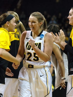 Iowa's Kali Peschel (25) is congratulated by teammate Alexa Kastanek (1) for making a three pointer during the second half in the Hawkeyes' 88-70 win over Miami. Peschel scored eight points off the bench.