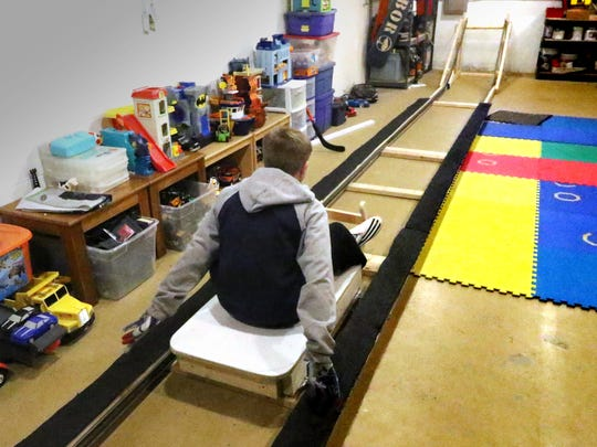 Marcus Mueller, 12, trains on a homemade Luge cart