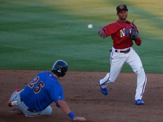 Shortstop Sergio Alcantara turns the double play during