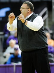 Evansville head coach Marty Simmons yells down court during their game against Wabash at the Ford Center in Evansville, Wednesday, Nov. 30, 2016.