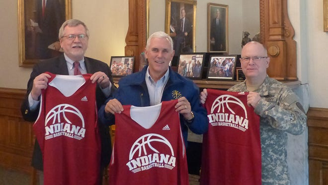 From left: IU's vice president of government relations Mike Sample, Gov. Mike Pence and Colonel Timothy Thombleson, Chief of Staff to the Indiana Guard Adjutant General.