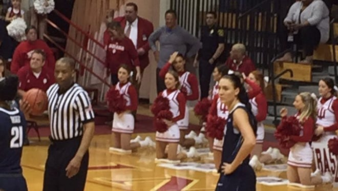 Former IU coach Tom Crean (center, in gray) watches IU women's basketball team in the NIT on Sunday at Assembly Hall.