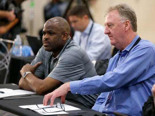 Indiana Pacers coach Nate McMillan, left, and Larry Bird watch NBA prospects at the leagues's draft basketball combine Thursday, May 11, 2017, in Chicago.